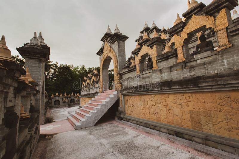 Buddhist Temple : Sandstone Pagoda in Pa Kung Temple at Roi Et of Thailand royalty free stock photo