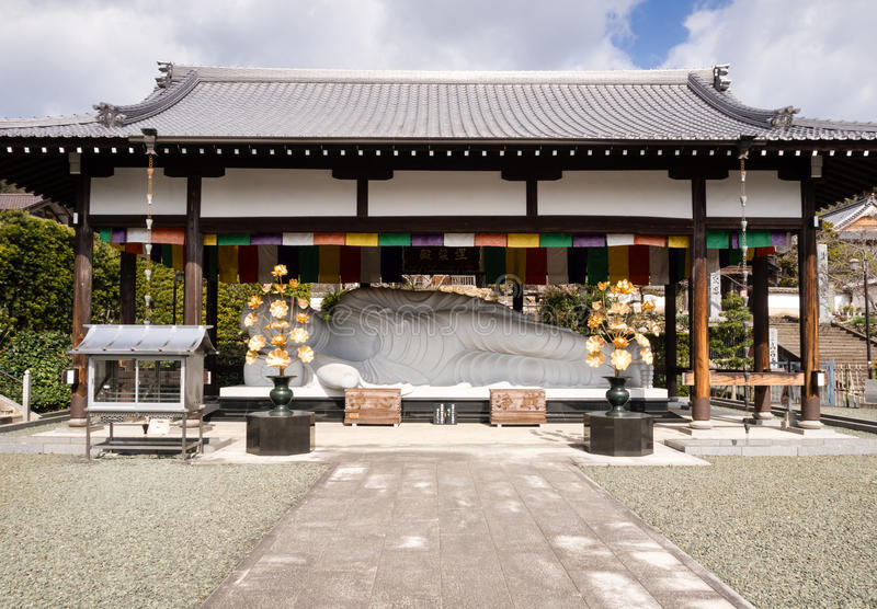 Buddhist temple with sleeping Buddha statue royalty free stock images