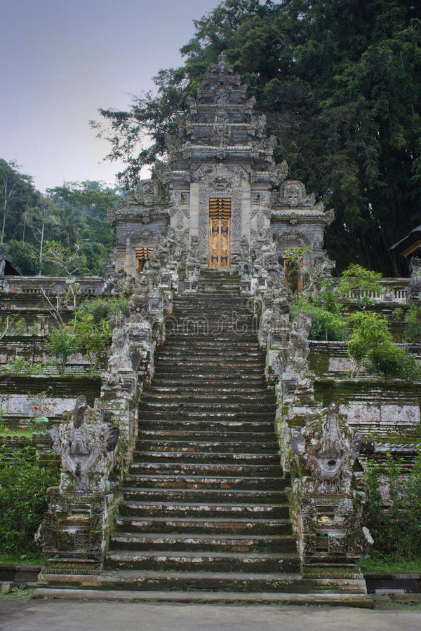 Buddhist temple stairs with statues in Bali, Indonesia stock images