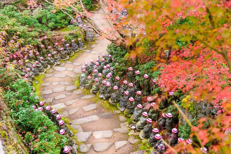 Buddhist Temple Trail. Miyajima Island, Hiroshima, Japan at the buddha lined pathways at Daisho-in Temple grounds royalty free stock image