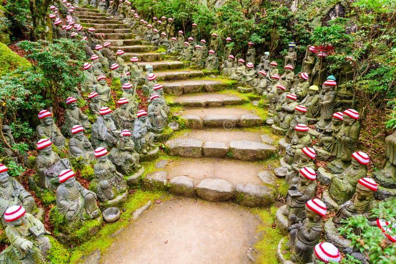 Buddhist Temple Trail. Miyajima Island, Hiroshima, Japan at the buddha lined pathways at Daisho-in Temple grounds royalty free stock photo