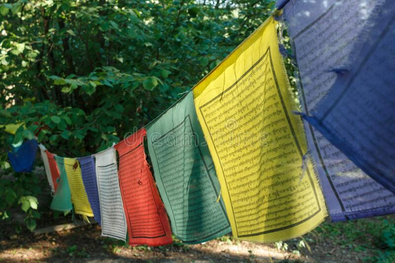 Buddhist Tibetan prayer flag colorful flag is different in five color meanings. Tibetan Prayer Flags. Buddhist praying flags stock images