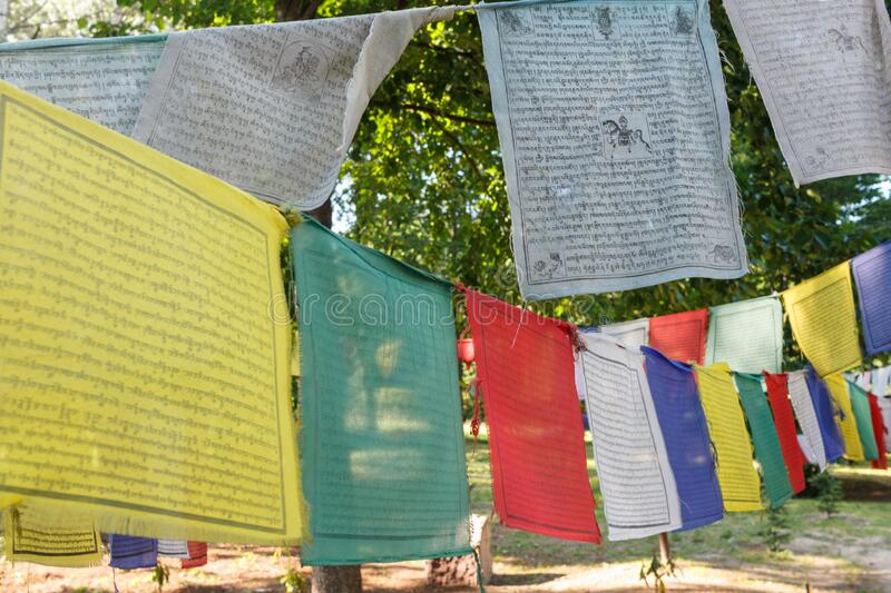 Buddhist Tibetan prayer flag colorful flag is different in five color meanings. Tibetan Prayer Flags. Buddhist praying flags stock photos