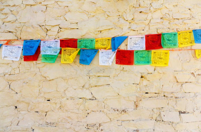 Download Buddhist Tibetan Prayer Flags Against Wall Stock Image - Image: 27715347