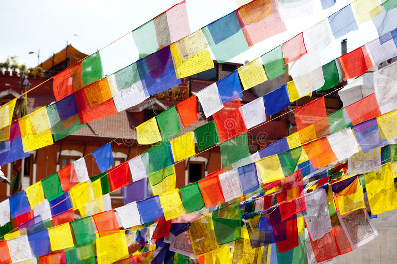 Buddhist Tibetan prayer flags lungta on Bodnath stupa royalty free stock photo