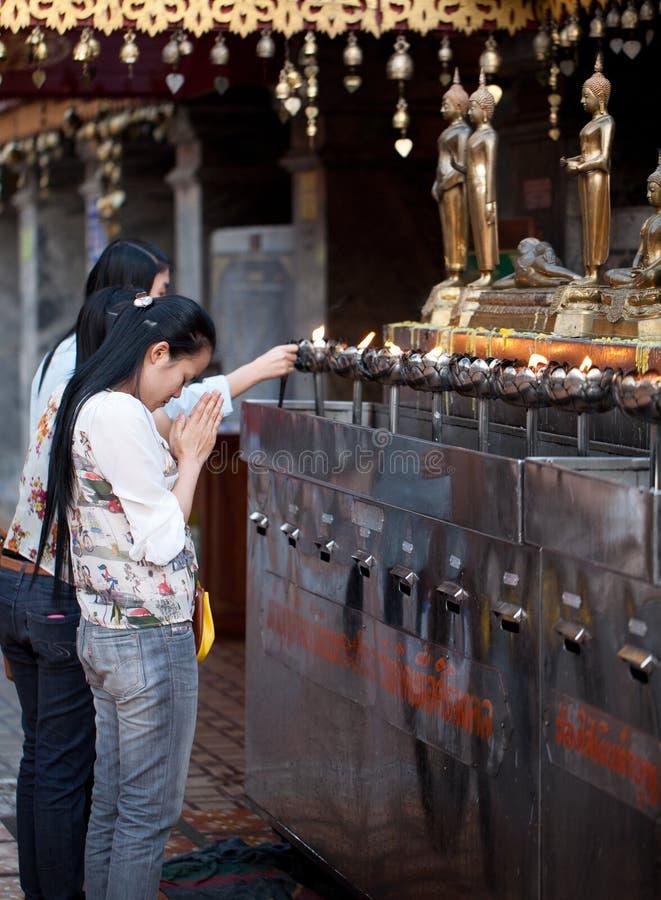 Buddhist woman praying on eve royalty free stock photo