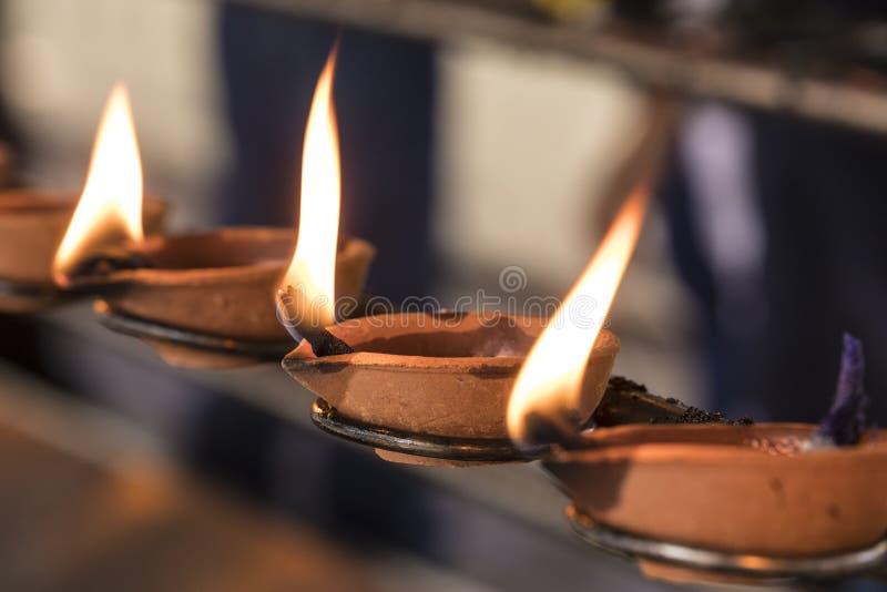 Buddhistic ritual: Burning lamp, so that a wish goes into fulfillment. Sri Lanka royalty free stock photos