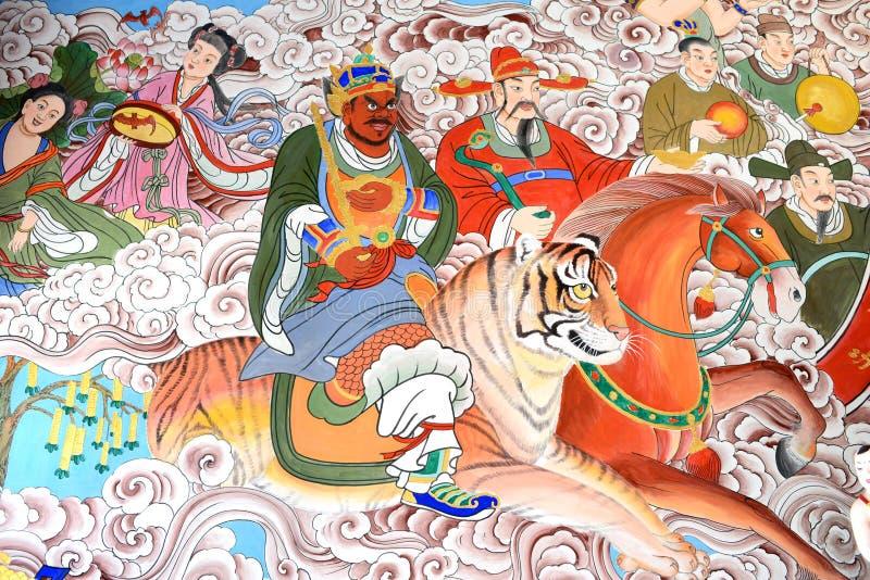 Buddhistische Kunst auf den Wänden stockfotos