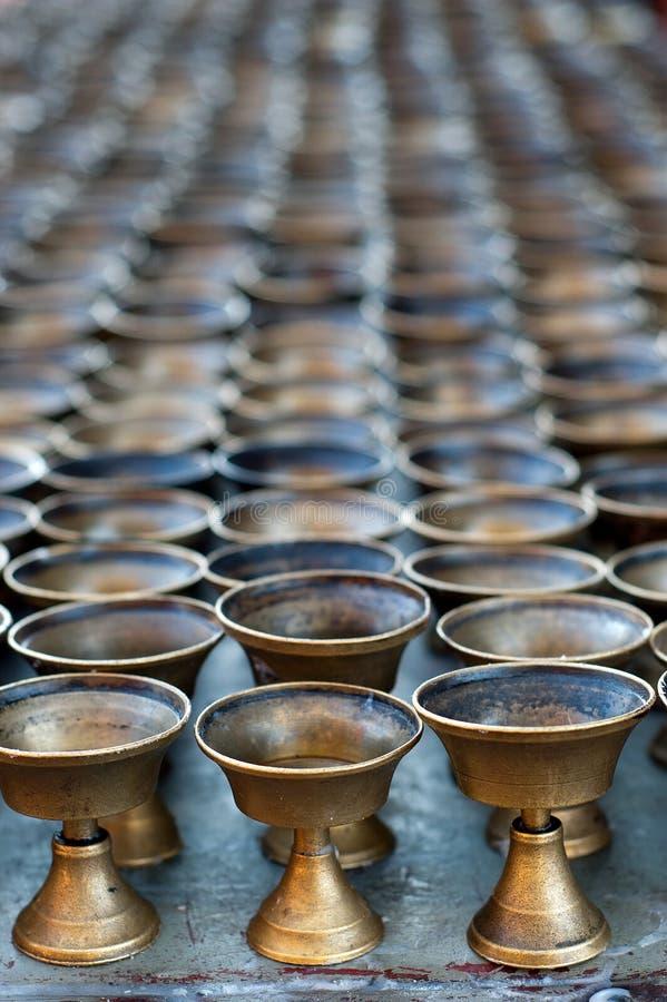 Buddhistische Schmieröllampen stockbild