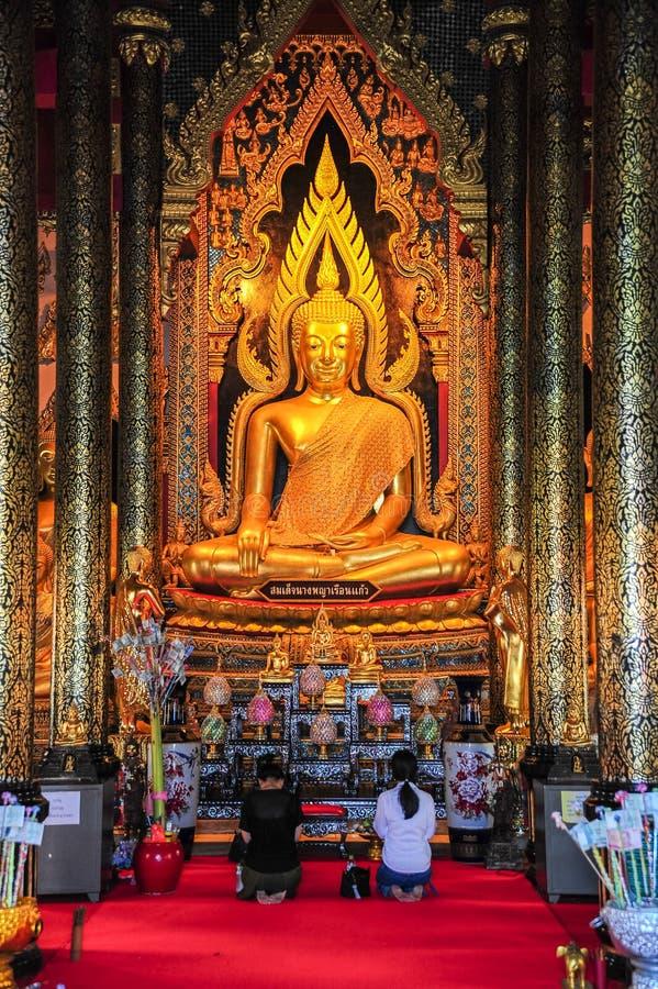 Buddhists worshiping beautiful Buddha image stock images
