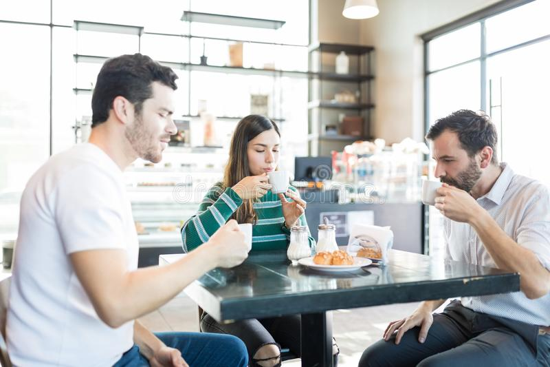 Buddies Having Refreshment In Coffee Shop royalty free stock photos