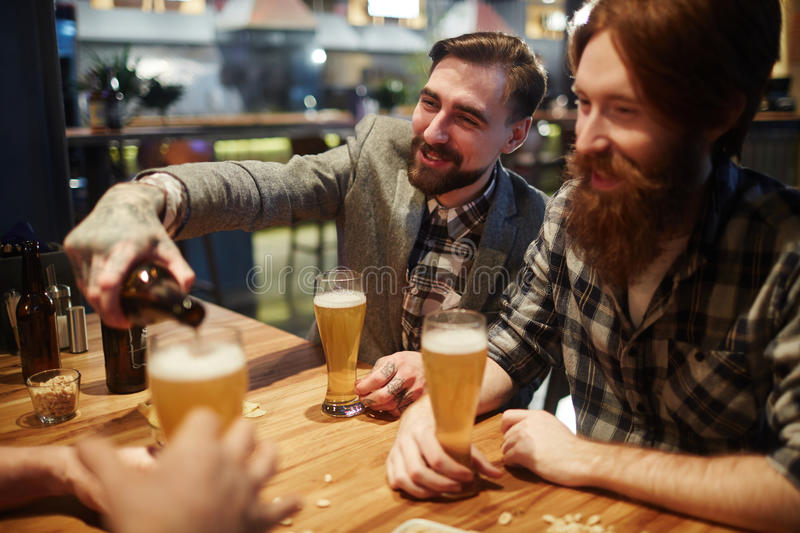 Buddies in pub stock photography