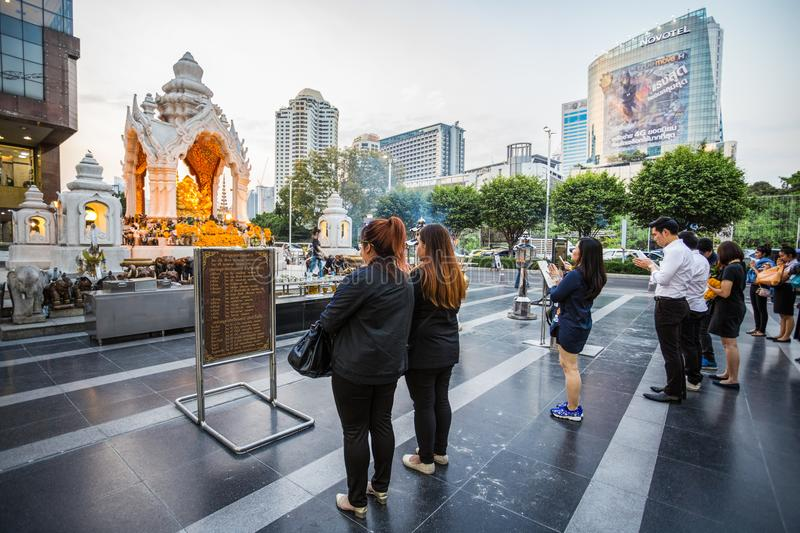 Buddisit faithful pray on Trimurti Shrine, located in front of Central World, is known as God of Love, granting happiness in roman royalty free stock photo