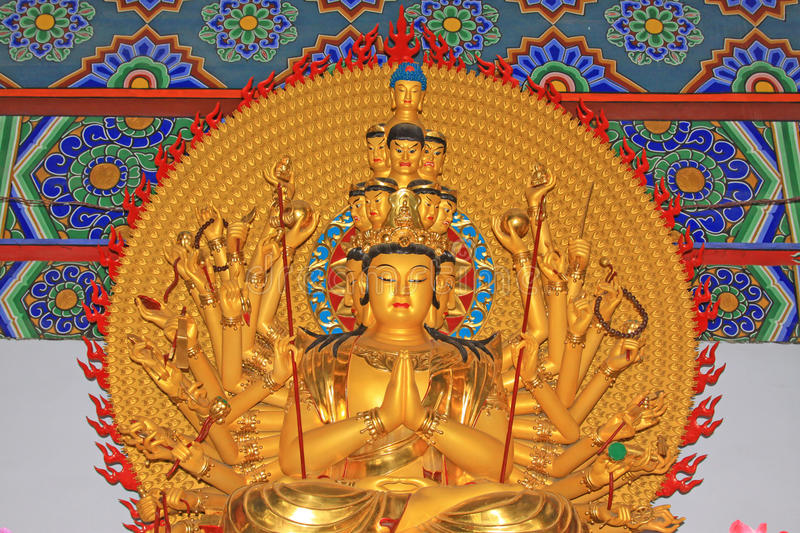 Buddism godness Guanyin statue in the hall in a temple. North China stock image