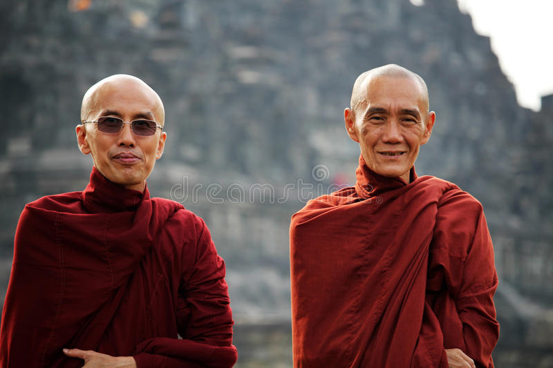 Buddist monks in Borobudur. Portrait of two buddist monks posing in front of Borobudur Buddhist temple complex in Central Java, Indonesia dating from the 8th royalty free stock image