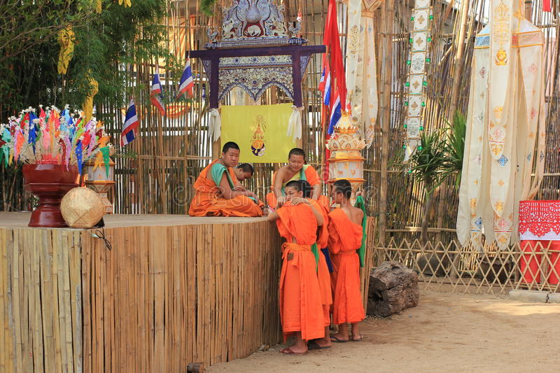 Buddhist monks at Wat Phan Tao temple, Chiang Mai, Thailand stock photography