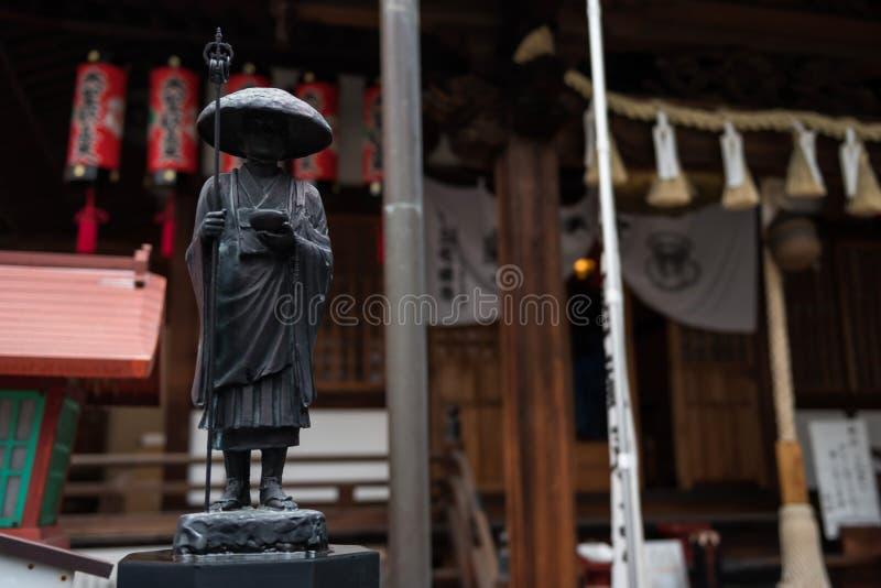 Buddyjska statua michaelity mienia kij obraz stock