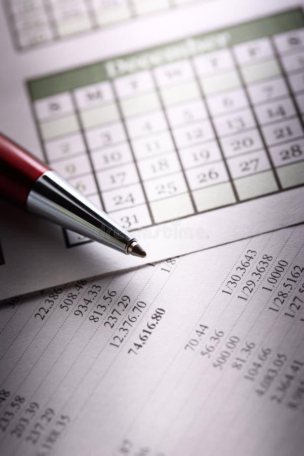 Budget, calendrier et stylo photo libre de droits
