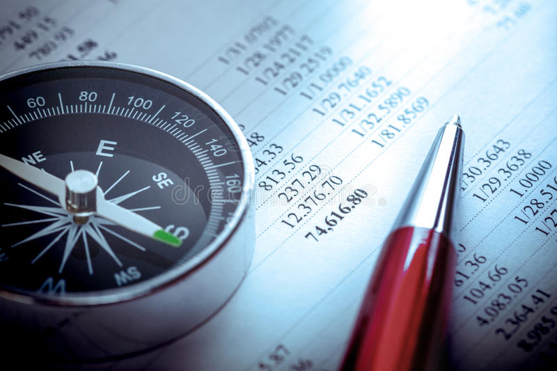 Budget, compass and pen. Annual budget, compass and pen on budget stock image