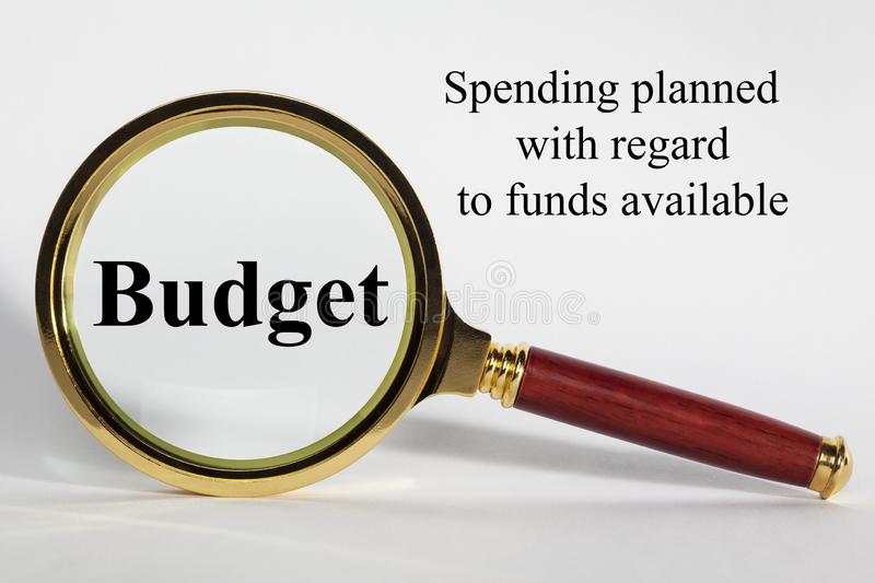 Budget Concept and Definition. Budget Concept - looking at Budget through a magnifying glass stock images