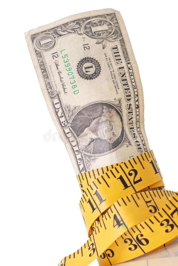 Budget Cuts. Concept With Money Wrapped With Tape Measure stock photo