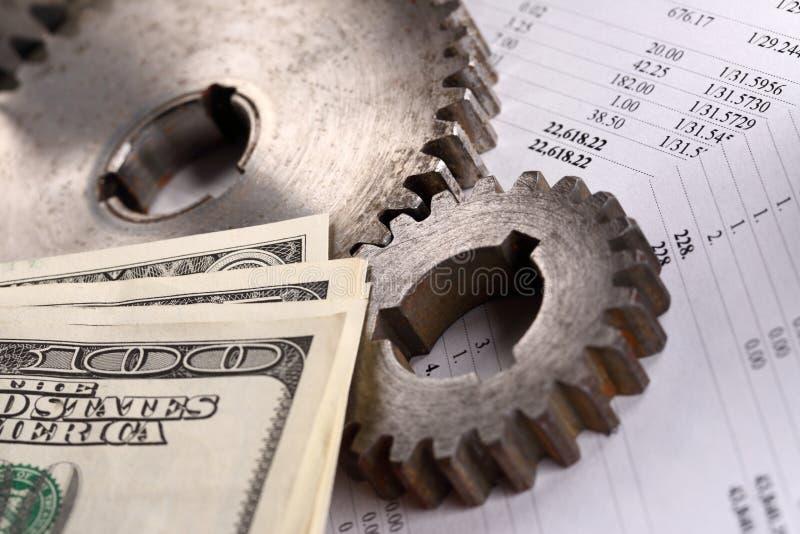 Budget, dollar och spärrhjular royaltyfri foto