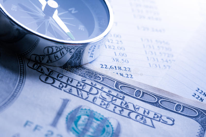 Budget, dollars et boussole image stock
