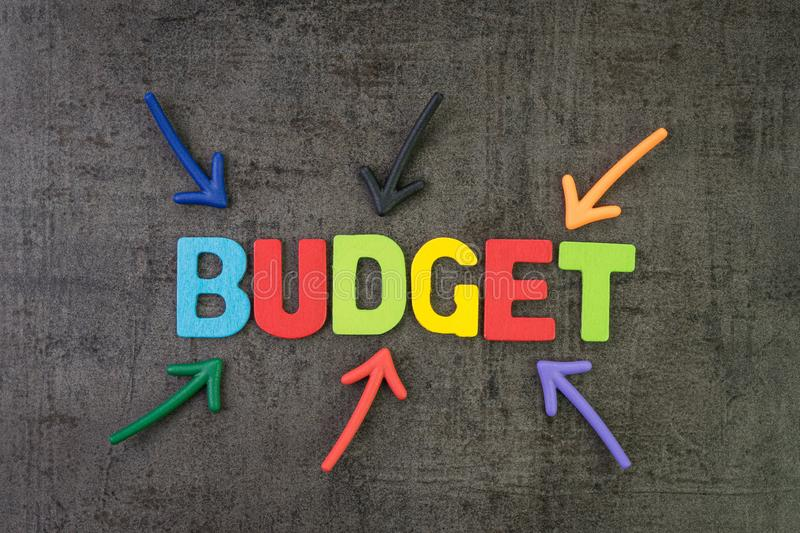 Budget, financial planning or balance calcultation concept, multi color arrows pointing to the word Budget at the center of black royalty free stock photos