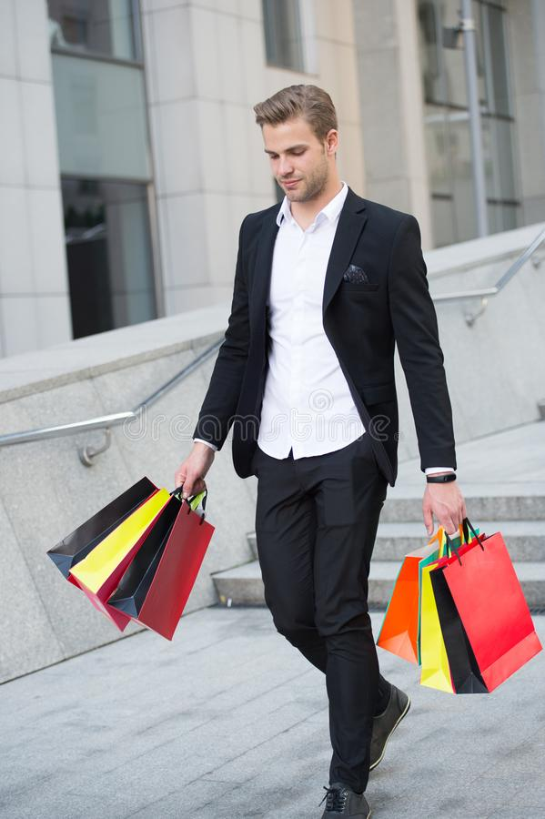 Budget limit. People overspend on things because they had no parameters around spending. Man happy carries bunch of bags stock photo