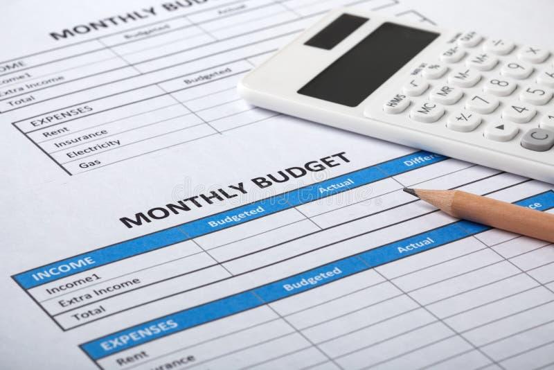 Budget mensuel avec la feuille mensuelle de budget photo libre de droits