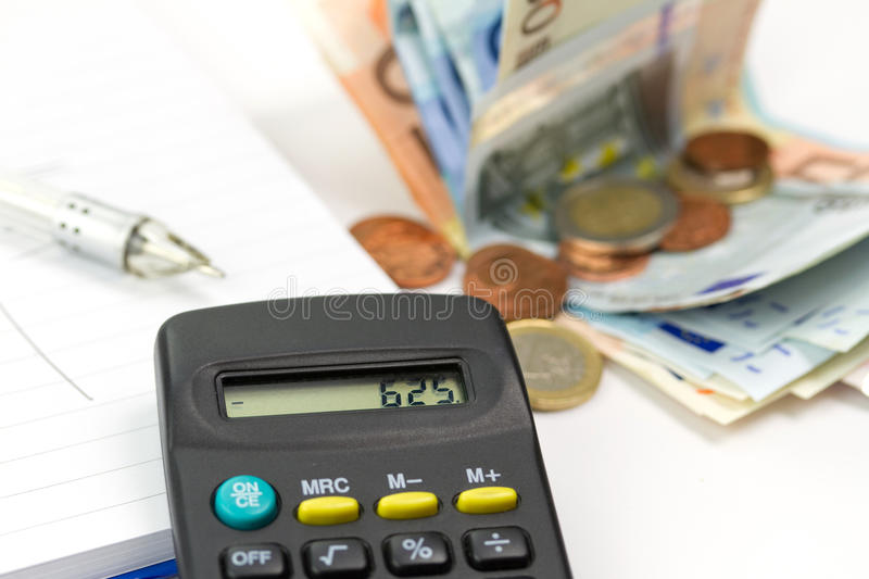 Budget on minus. Home budget counting with calculator and pen royalty free stock photography