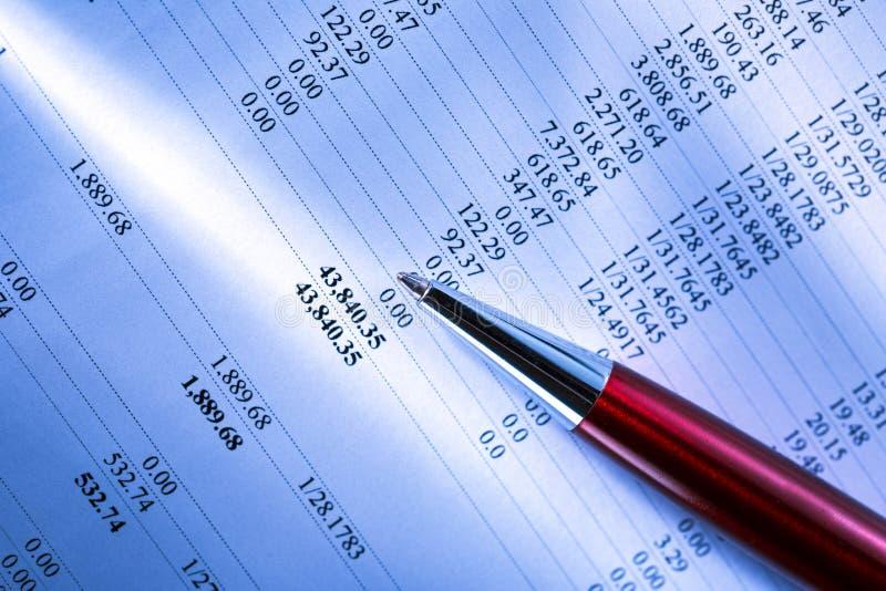 Budget and a pen stock photos