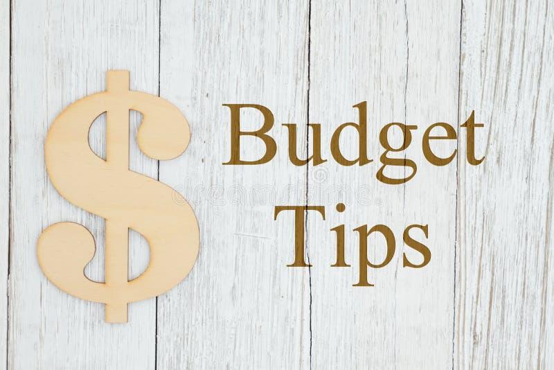 Budgetspetsmeddelande med ett trädollartecken arkivfoto