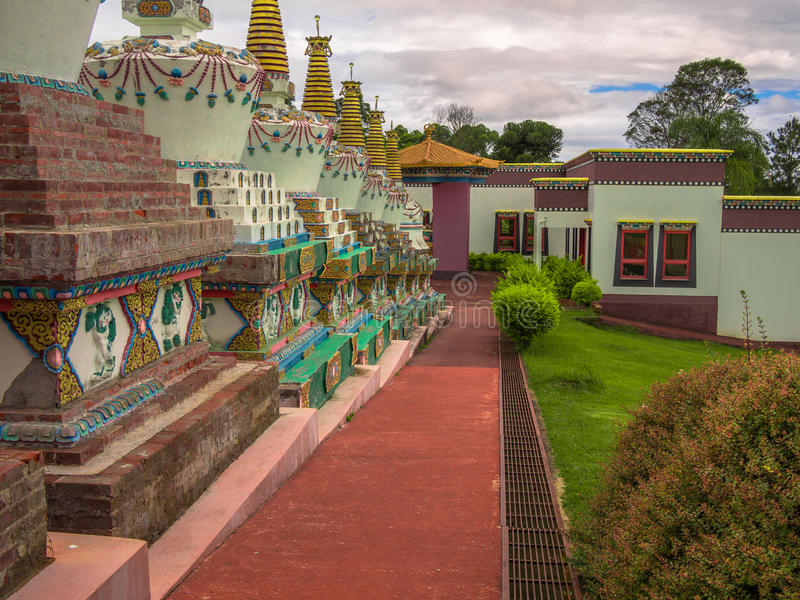 Buddhist temple. In Gramado - Tres Coracoes - Brazil, the red and gold contrasts with the grey clouds in the sky royalty free stock photography