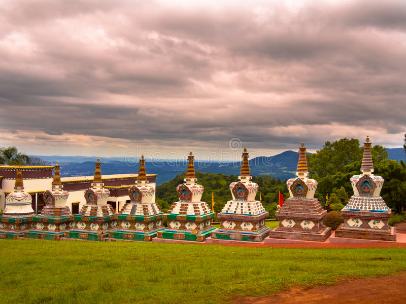 Buddhist temple. In Gramado - Tres Coracoes - Brazil, the red and gold contrasts with the hard clouds in the sky stock image
