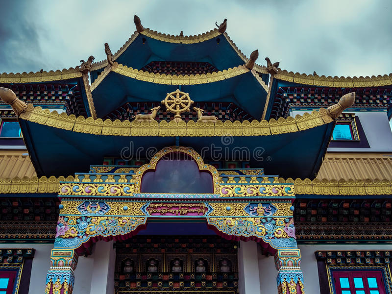Buddhist temple. Roof Buddhist temple in Gramado - Tres Coracoes - Brazil, the red and gold contrasts with the grey clouds in the sky stock photos