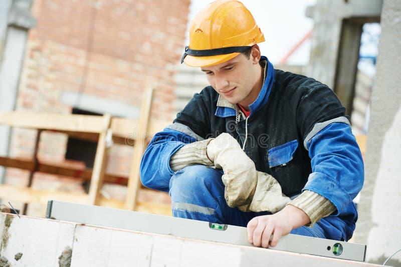 Budowa kamieniarza pracownika murarz zdjęcie stock