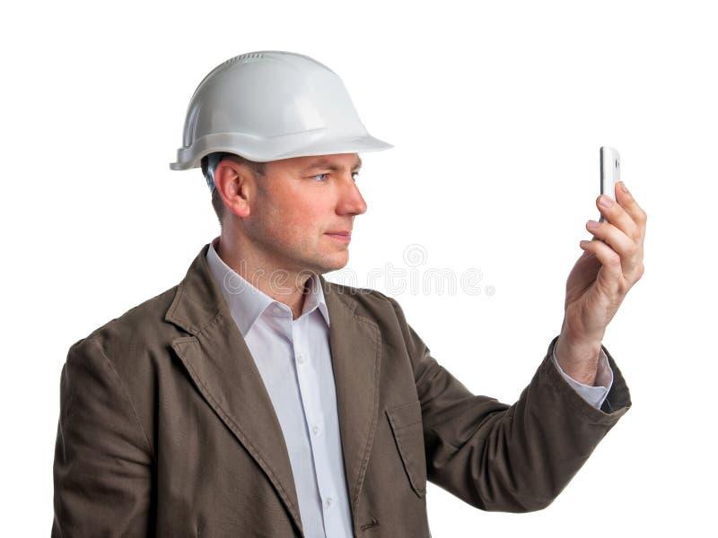Budowa nadzorca robi telefon fotografiom zdjęcia royalty free