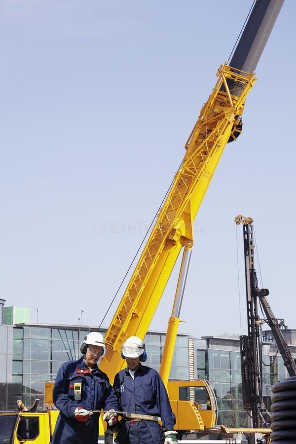 Budowa pracownicy i maszyneria zdjęcie stock