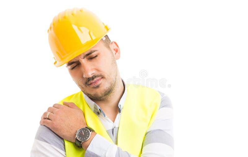 Budowniczego lub pracownika budowlanego cierpienia ramienia bólu problem zdjęcie stock