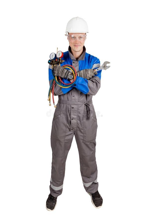 Budowniczy, installer wentylacja z narzędziami w rękach obrazy stock