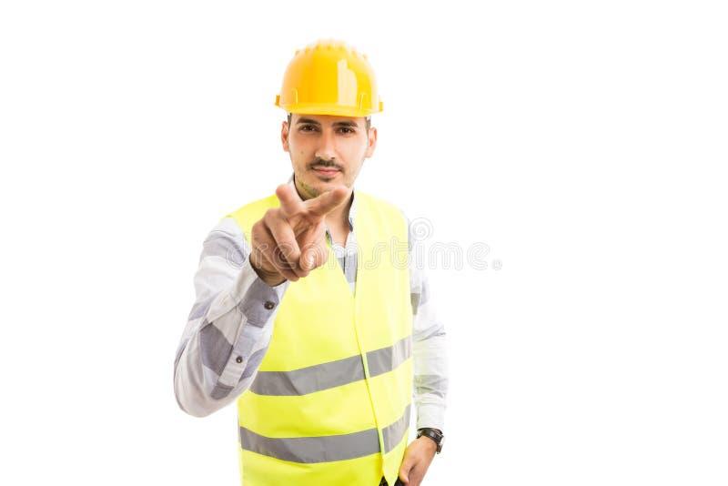 Budowniczy lub pracownik robi I ` m ogląda was gestykulujemy fotografia royalty free
