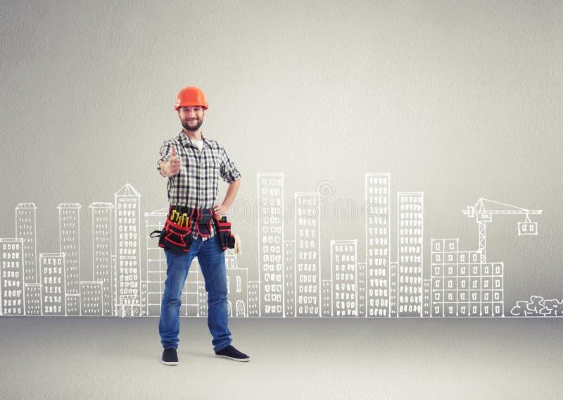 Budowniczy pokazuje aprobaty fotografia royalty free