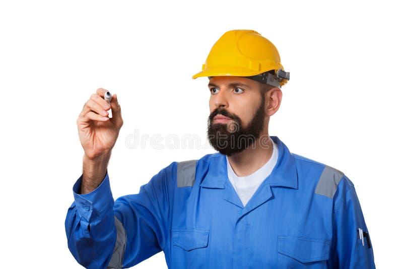 Budowniczy w ci??kim kapeluszu, brygadierze lub repairman w he?mie, Brodaty m??czyzny pracownik z brod? w budynku he?mie lub ci?? obraz royalty free