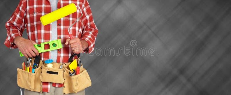 Budowniczy złota rączka z farba rolownikiem zdjęcia royalty free