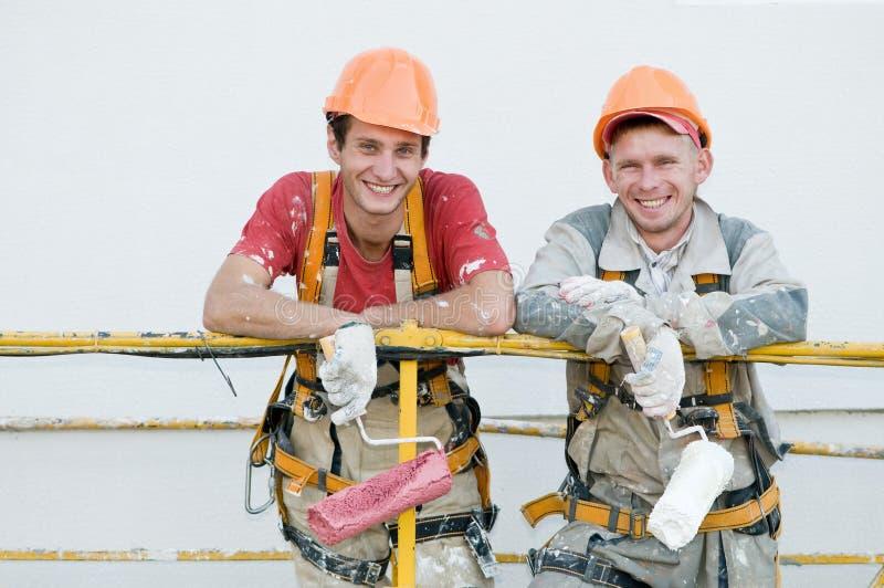 budowniczych malarzi fasadowi szczęśliwi fotografia royalty free