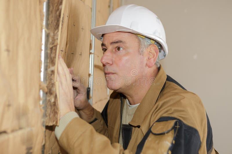 Budowy estimator sprawdza ścianę obraz stock