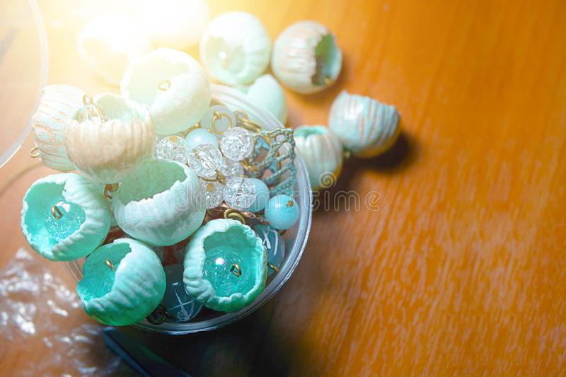 Buds of polymer clay on the wooden desk. Overhead view buds of polymer clay on the wooden desk. Creative process. Copy space, flat lay royalty free stock image