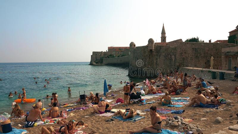 BUDVA, MONTENEGRO - AUGUST 2, 2018. Crowded beach near the Old town stock photography