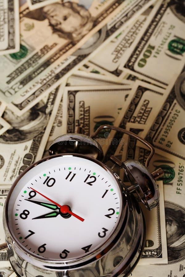 budzik pieniądze obraz royalty free